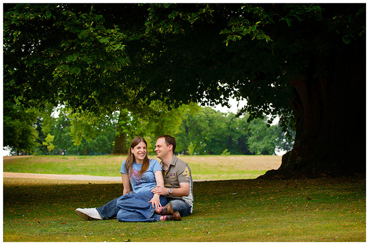 spains hall pre wedding photography couple sitting on ground under tree