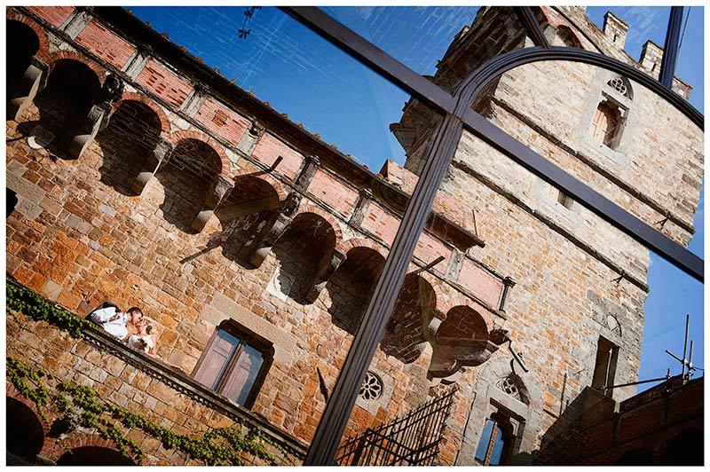 bride groom kiss in castle in italy