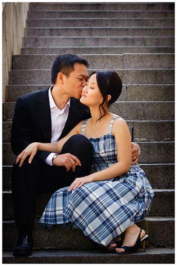 Couple kissing whilst sat on Paris steps
