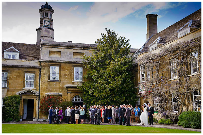wedding party outside christs college chapel