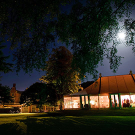 longstowe hall marquee at night during a wedding
