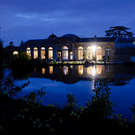 woburn sculpture gallery at night across lake