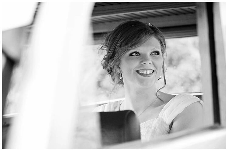 Tythe Barn Bicester Wedding bride sat in car