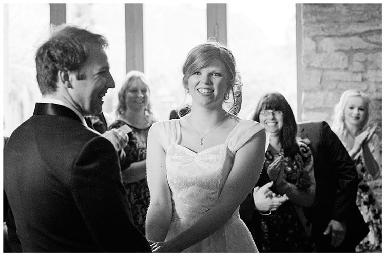 Tythe Barn Bicester Wedding laughing bride groom during service
