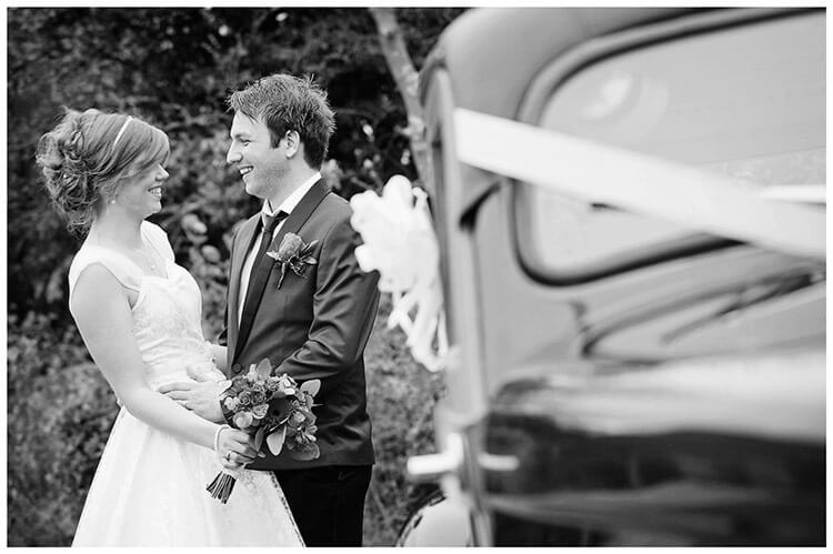 Tythe Barn Bicester Wedding bride groom portrait side car