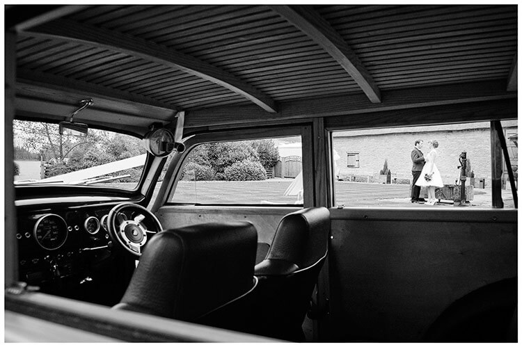 Tythe Barn Bicester Wedding bride groom portrait through wedding car window