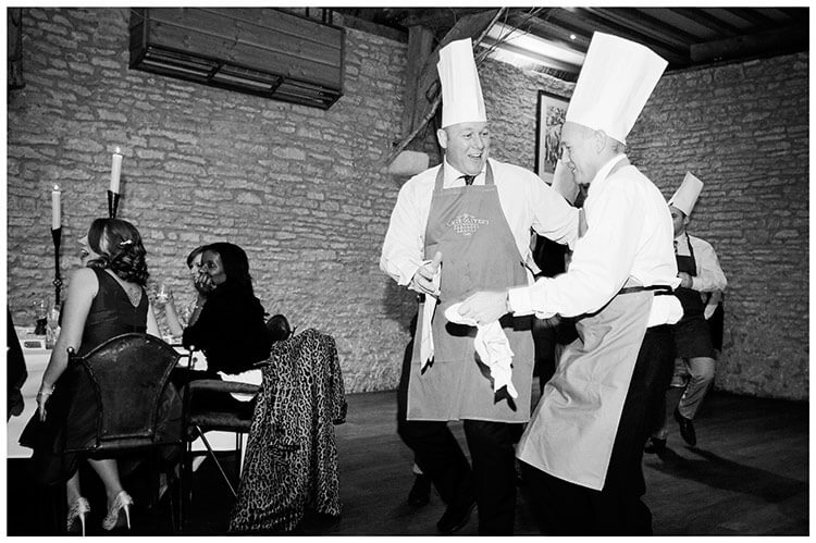 Tythe Barn Bicester Wedding guests dressed as dancing chefs