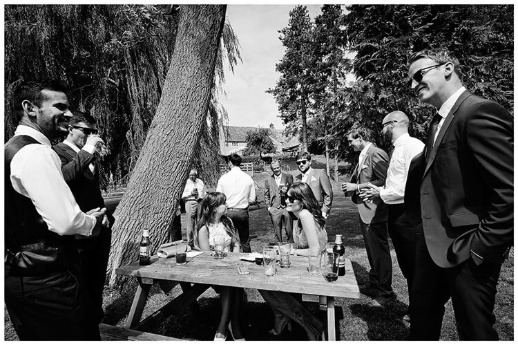 wedding guests beer garden before ceremony