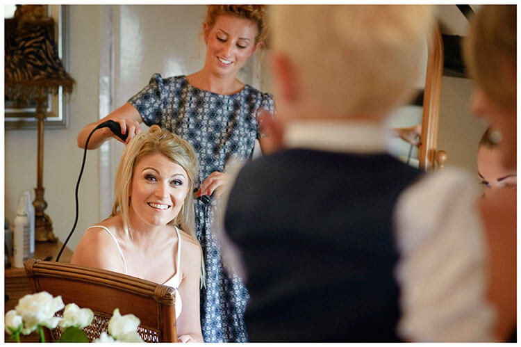 bride during getting ready talks to young boy