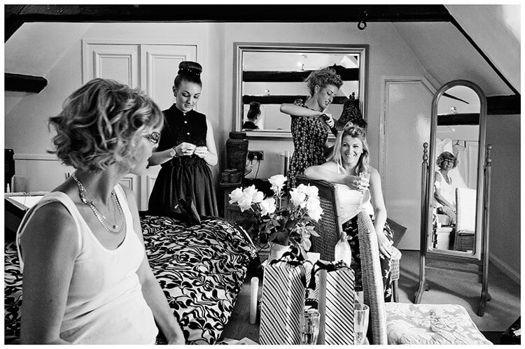 bride mother getting ready in bridal suite