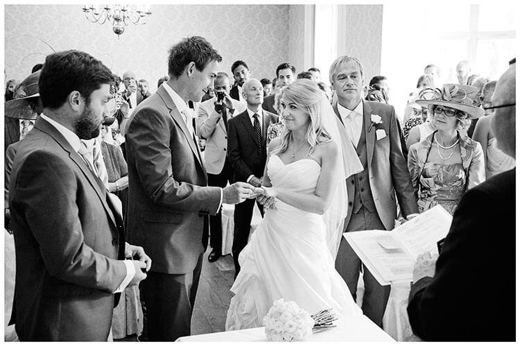 bride groom looking at each other during exchange rings