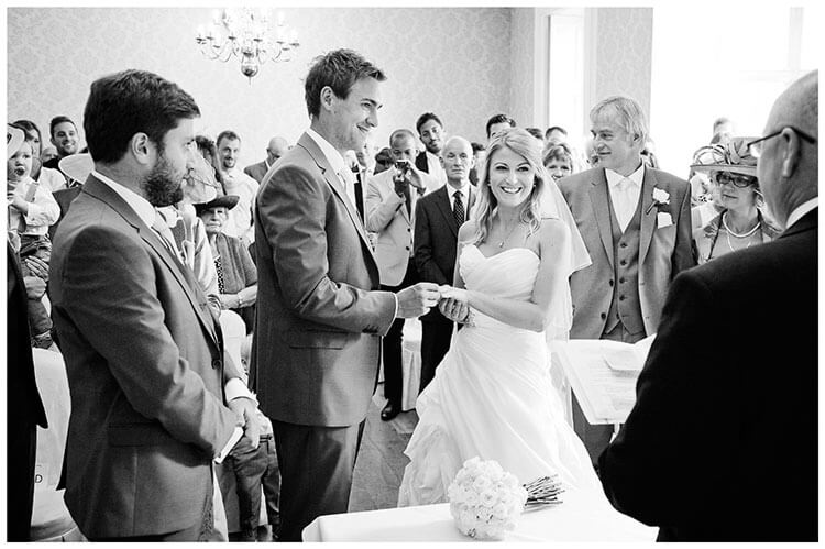 smiling exchanging rings
