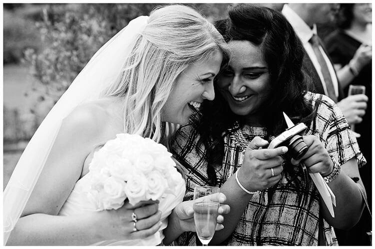 bride looking at photo on camera