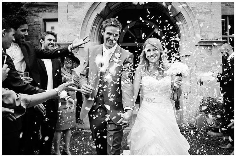 confetti in front wadenhoe house wedding venue