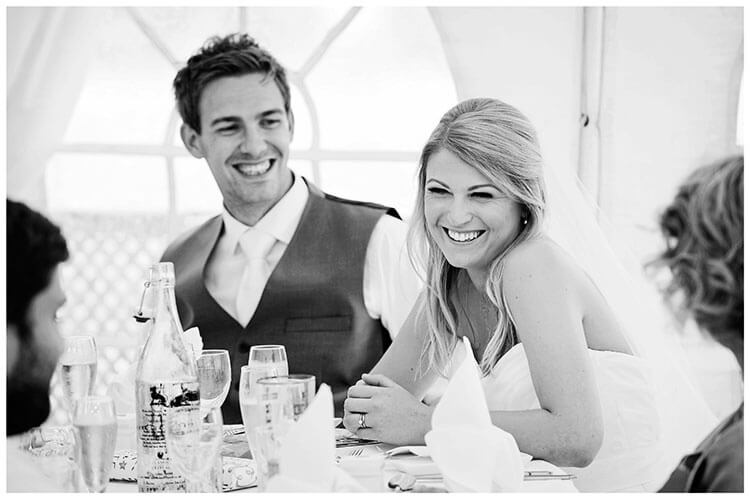 bride groom laughing during speches