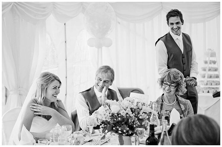 groom looking at bride during speech