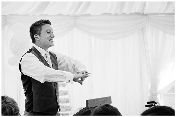 best man flexing hands before starting speech