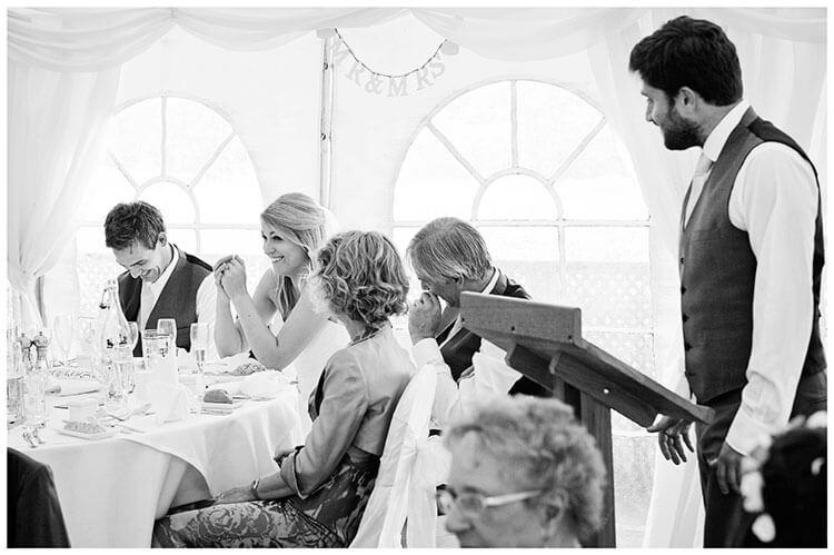 best man speeches groom bows head bride laughs