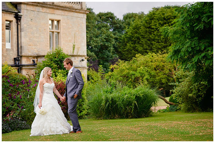 bride groom holding hands wadenhoe house wedding