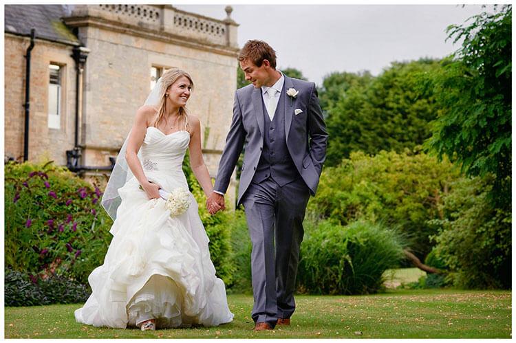 romantic bride groom walking wadenhoe house wedding