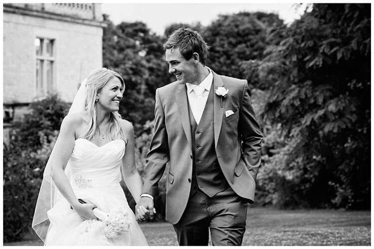 smiling bride groom walking