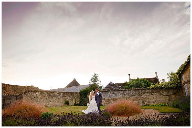 bride groom lavender dramatic sky