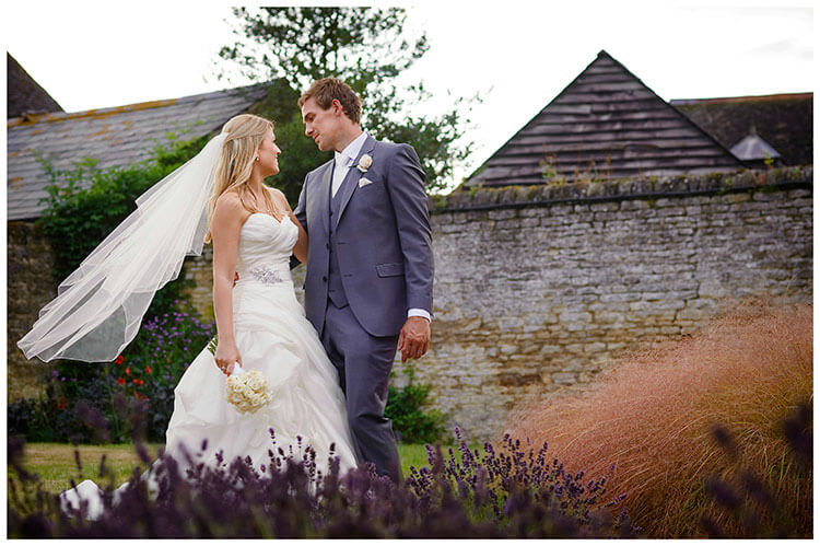 purple lavender bride groom stone wall