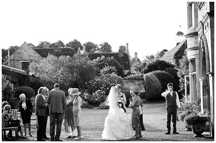 bride guests outside wadenhoe house wedding