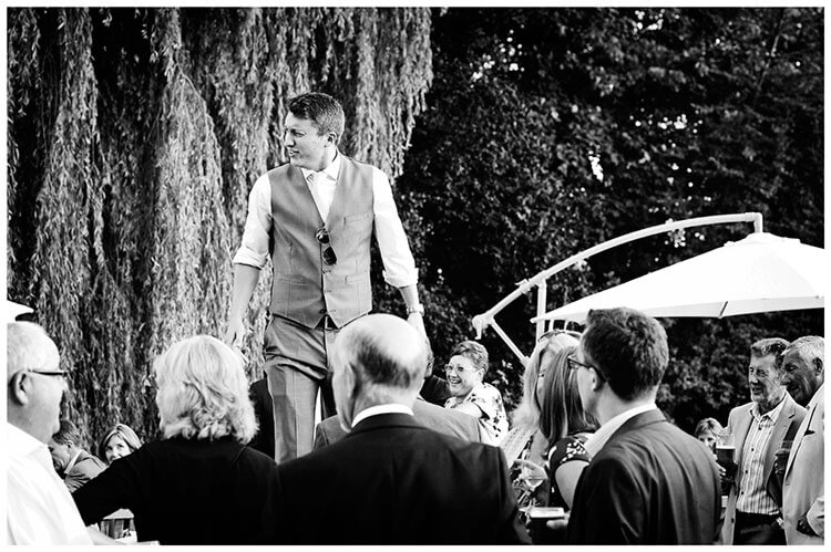 bestman on table talking to guests