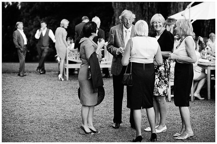 older wedding guests talking outside
