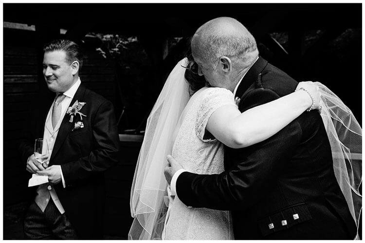 heartfelt moment when bride hugs her father