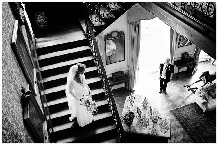 bride sees father as she comes down stairs