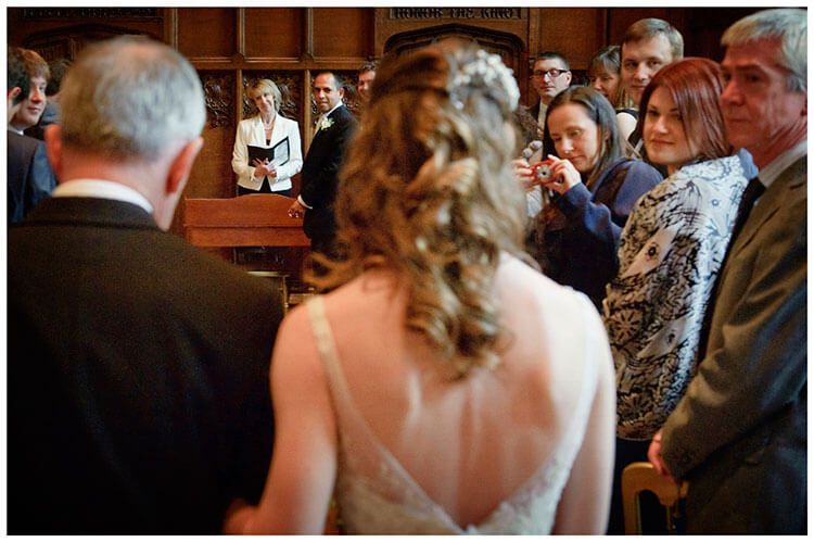 groom sees bride as she enters ceremony room