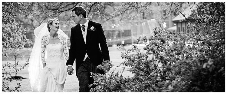 homerton college bride groom tom ellen walking hand in hand