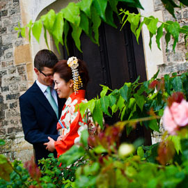 bride groom embrace in garden doorway