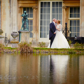 bride groom kiss by lake at Bedfordshire Wedding venue Woburn Sculpture Gallery
