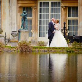bride groom kiss by lake at Bedfordshire Wedding venue Woburn Sculpture Gallery