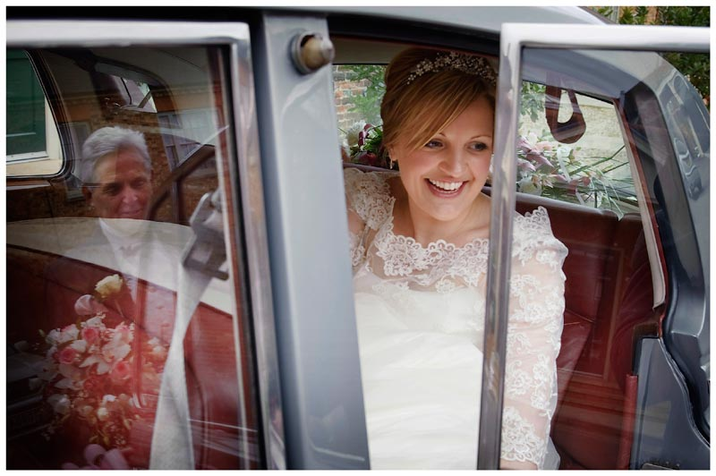 bride in car father reflected in window