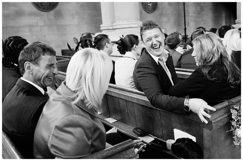 woburn abbey wedding guests laughing in church