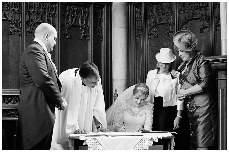 woburn abbey wedding bride signing the register