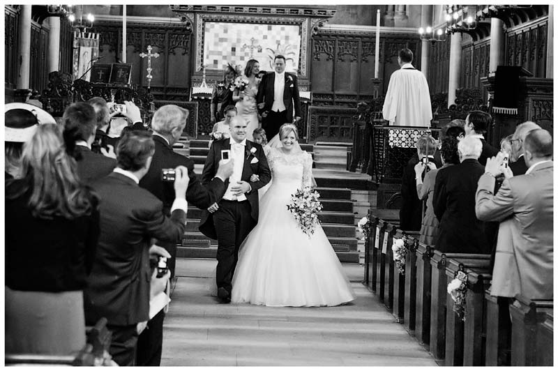 woburn abbey bride and groom walking down aisle