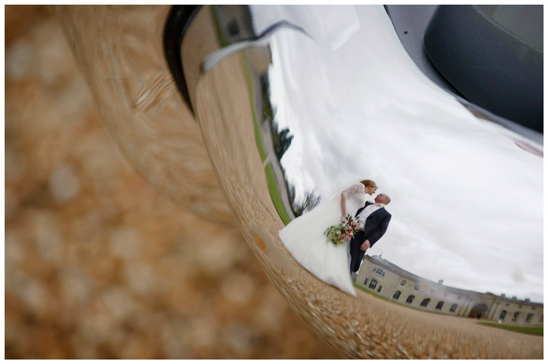 bride groom reflected in car bumper at Woburn Sculpture Gallery
