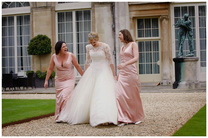 woburn sculpture gallery wedding bride and bridesmaids walk and laugh