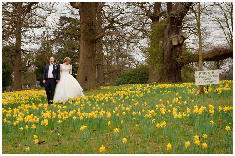 woburn sculpture gallery wedding do not enter sign bride groom walking through daffodils