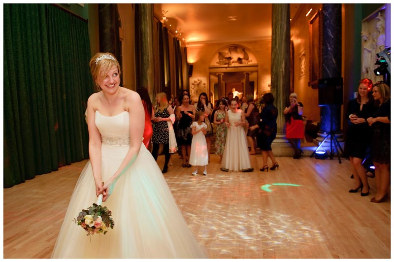 bride ready to throw bouquet at Woburn Sculpture Gallery wedding