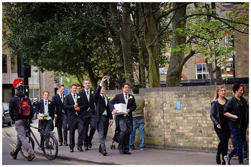OLEM Church Wedding Cambridge grooms men take selfie walking