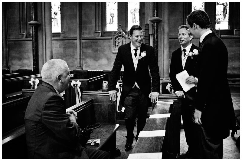 grooms men inside OLEM Church Cambridge