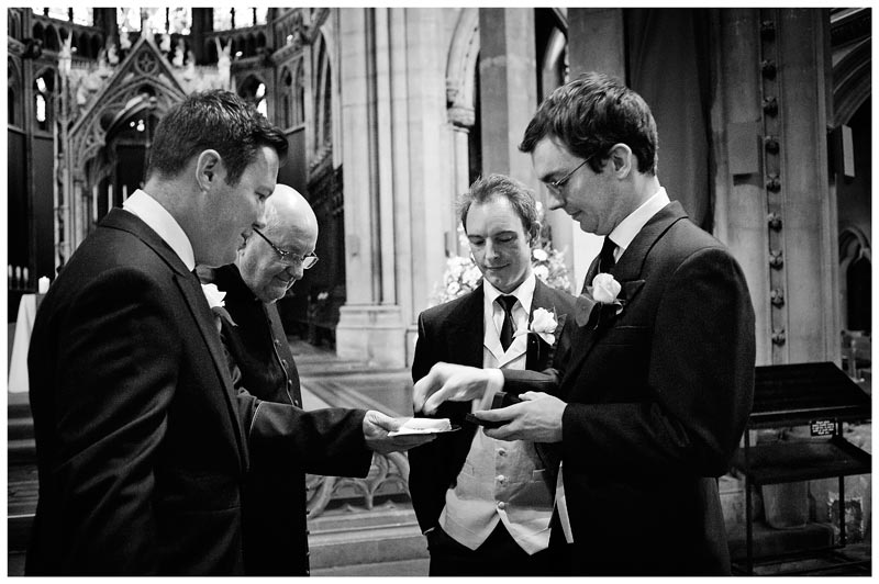 best man hands over rings to vicar of OLEM Church Cambridge