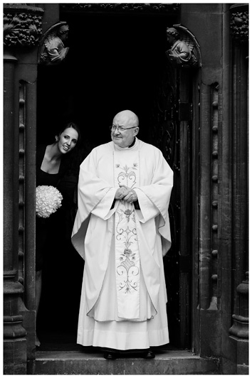OLEM Church Wedding Cambridge vicar bridesmaid in door way