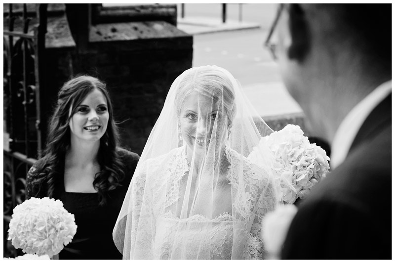 smiling bride and father first look outside OLEM Church Cambridge